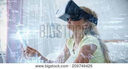 Illustration of mathematical equations with solution against girl holding tablet while wearing virtual reality simulator