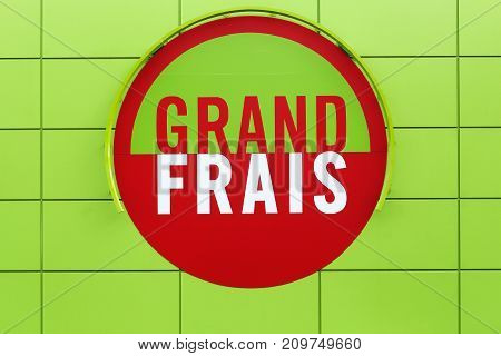Ferney, France - October 1, 2017: Grand Frais supermarket logo on a wall. Grand Frais is a French supermarket brand, specializing in fresh produce and in the world's grocery store