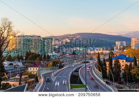 Aerial view of city mountains and highway