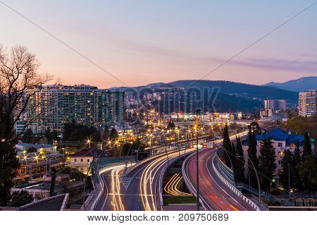 Beautiful aerial view of city mountains and highway