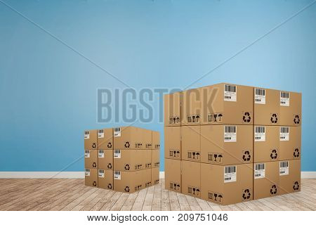 Digitally generated image of cardboard boxes against room with wooden floor