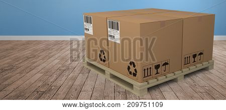 Brown cardboard boxes arranged on wooden pallet against room with wooden floor