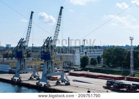 GDANSK, POLAND - 16 SEPTEMBER: Cranes on dockside on 16 September 2017 in Gdansk, Poland. Nowy Port is one of quarters of Gdansk.