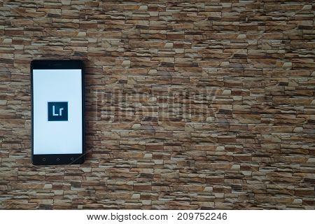 Los Angeles, USA, october 19, 2017: Adobe photoshop lightroom logo on smartphone screen on stone facing background