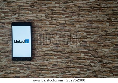 Los Angeles, USA, october 19, 2017: Linkedin logo on smartphone screen on stone facing background