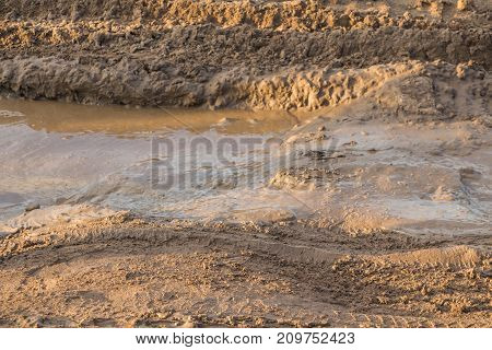 Texture of muddy road after rain in the summer