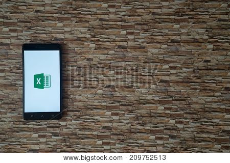 Los Angeles, USA, october 19, 2017: Microsoft office excel logo on smartphone screen on stone facing background
