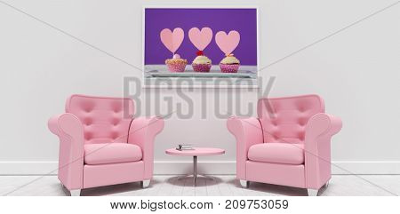 Pink armchairs and table against blank picture frame  against close-up of three delicious cupcakes with heart shape cards in tray
