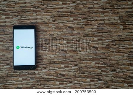 Los Angeles, USA, october 19, 2017: Whatsapp logo on smartphone screen on stone facing background