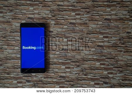 Los Angeles, USA, october 19, 2017: Booking.com logo on smartphone screen on stone facing background