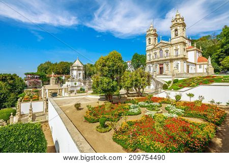 Historic Church of Bom Jesus do Monte and her public garden. Tenoes, Braga. The Basilica is a popular landmark and pilgrimage site in northern Portugal. Aerial landscape on the top of Braga mountain.