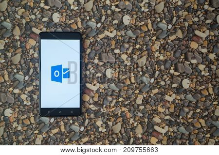 Los Angeles, USA, october 18, 2017: Microsoft office outlook logo on smartphone on background of small stones