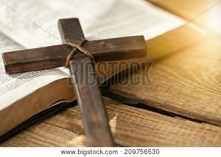 Book holy bible table background light old