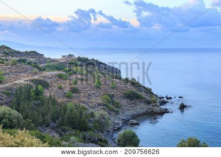 Ruins of old house on the hill near seaside