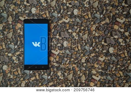 Los Angeles, USA, october 18, 2017: Vkontakte logo on smartphone on background of small stones