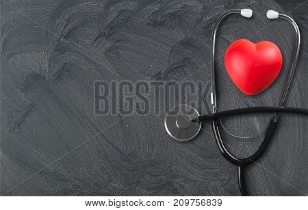 Medical heart stethoscope red objects blue background