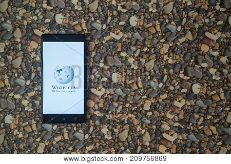 Los Angeles, USA, october 18, 2017: Wikipedia logo on smartphone on background of small stones