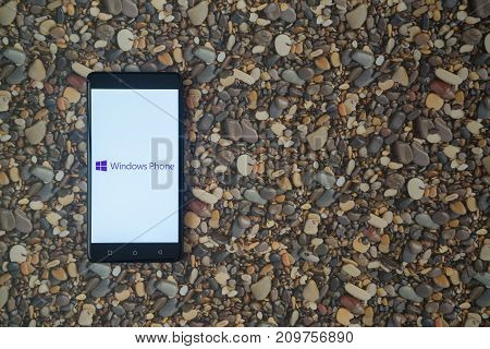 Los Angeles, USA, october 18, 2017: Windows phone logo on smartphone on background of small stones