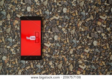 Los Angeles, USA, october 18, 2017: Youtube logo on smartphone on background of small stones