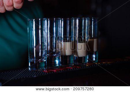 Preparation of shots cocktails. Close-up