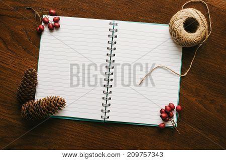 Christmas or New Year Border. A notebook with blank sheets with copy spase for letter or message.