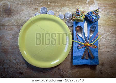 Casual country Hanukkah dinner place setting with colorful dreidels and gelt