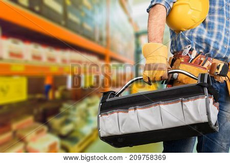 Young man worker color yellow background view