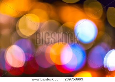 Cars drive through the night street. Abstract background of big city lights.