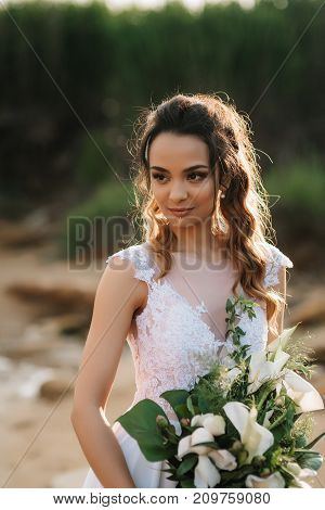 Bride With A Wedding Bouquet On The Shore  Sea