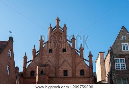 Striking architecture of roof of government building behind Old Main Town Hall in Gdansk Poland
