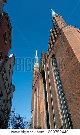 Brick exterior of the Basilica of the Assumption of the Blessed Virgin Mary in Gdansk, Poland