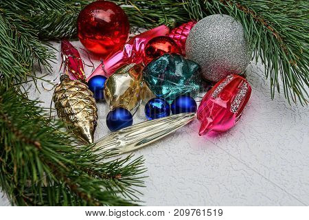 beautiful colored New Year's toys in green coniferous branches