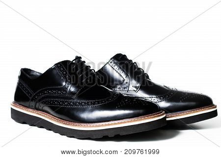 Black leather male shoes in white background