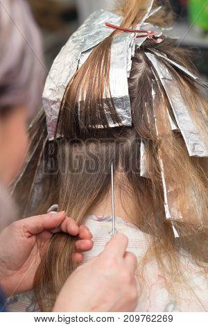 weave hair in beauty salon . photo in the studio