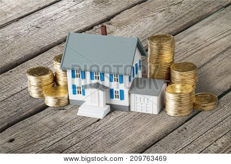 Model house coins table expensive background money