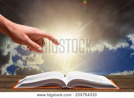 Hand book holy bible table background sky