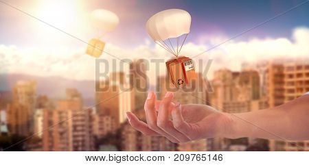 Hand of man pretending to hold an invisible 3D object against scenic view of bright sun over white cloudscape