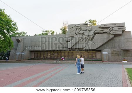 Tourists Stand Near The Memorial Of Heroic Defense Of Sevastopol In 1941-1942 During The Second Worl