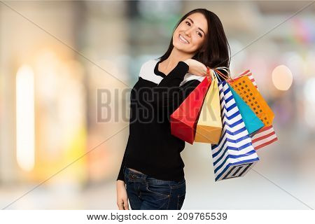 Shopping shop young woman bags background luxury