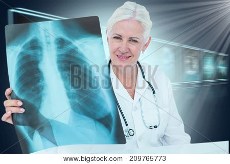 Portrait of smiling female doctor examining chest X-ray against composite 3D image of different application interface