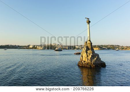 Monument To The Scuttled Ships In The Sevastopol Bay. At Sea, Sailing Ships. Sunset