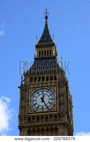 A view of a large clock face and tower in London