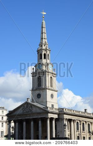 An external view of a church building with spire in London