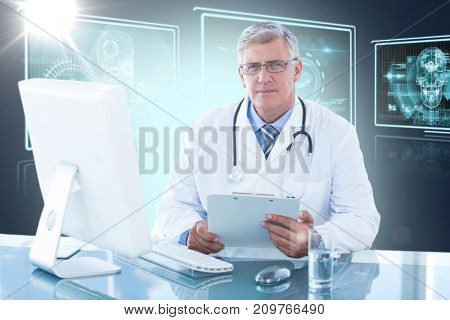 Portrait of confident male doctor sitting at computer desk against composite 3D image of different application interface