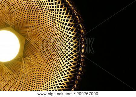 The handmade Woven wood lamps to decorated on the ceiling light spotting. This is the art of culture in Asia.