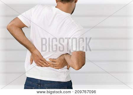 Young man back pain young adult white background