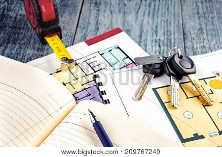 Linking new key on project plan of apartment house Concept new residence house warming Buying Selling Real Estate