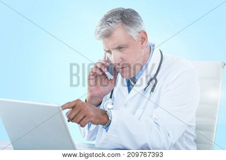 Male doctor pointing at laptop while using 3D mobile phone against blue vignette background