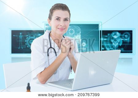 Confident female doctor with laptop on table against 3D blue vignette background