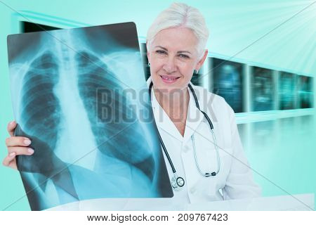Portrait of smiling female doctor examining chest X-ray against 3D blue vignette background